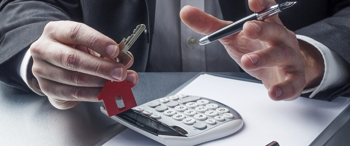 calculator and keys to property